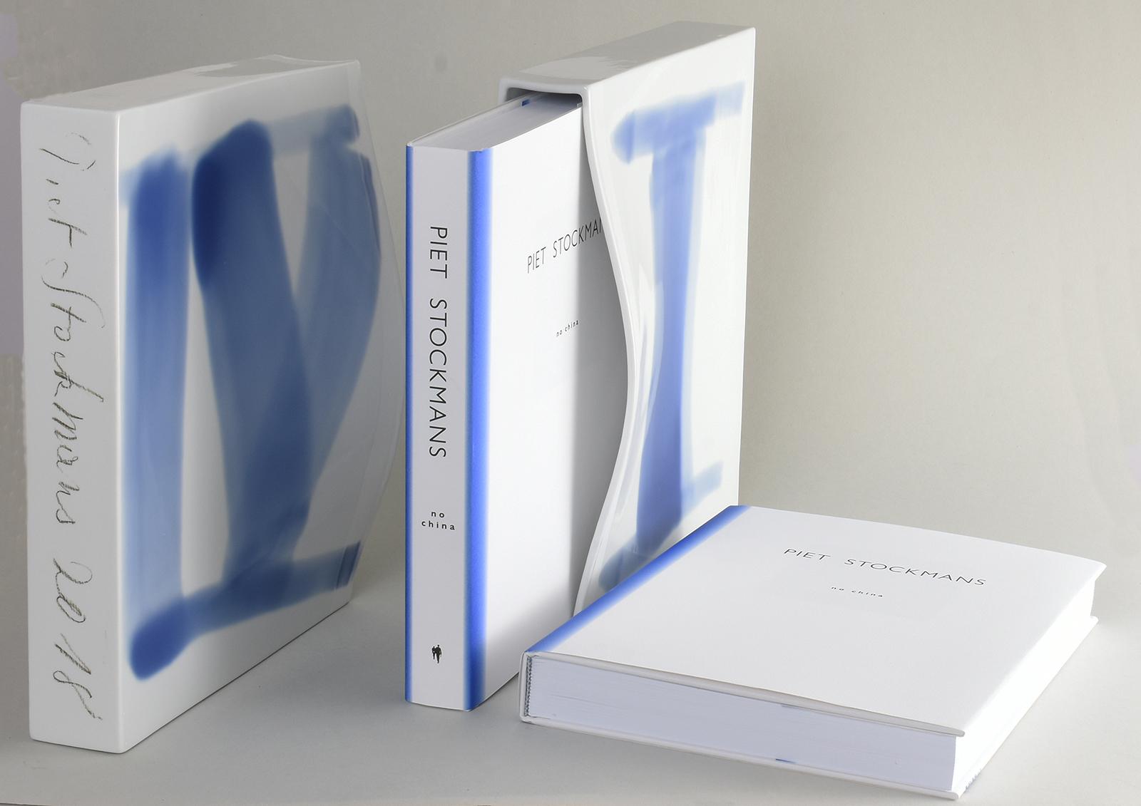 Porcelain Case with Book. Each case has a unique roman number (I - C) which makes them Unique.